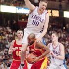Center Greg Ostertag fouls an Iowa State player during a 1995 game. Ostertag, who helped the Jayhawks reach the 1993 Final Four, finished his Kansas career as the school's all-time leader in blocked shots.
