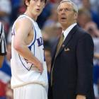 Roy Williams and point guard Kirk Hinrich look onto the court in the closing moments of the Jayhawks' 2003 title game loss to Syracuse. Hinrich teamed with Collison to lead Kansas to two straight Final Four's. Like his teammate and fellow Iowan Collison, Hinrich's Kansas jersey is retired.