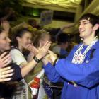 Kirk Hinrich greets fans at Forbes Field Airport in Topeka, Kansas upon the Jayhawks' return from their 2003 Elite Eight victory over Arizona.