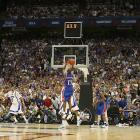 Mario Chalmers hits a game-tying three over Memphis point guard Derrick Rose to force overtime in the 2008 NCAA championship game. Kansas, which was down nine with 2 minutes, 12 seconds remaining, easily handled Memphis in overtime, beating the Tigers 75-68.