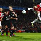Arsenal defender Laurent Koscielny heads in a corner kick against AC Milan during the sides' Champions League Round of 16 second leg. AC Milan lost the match 3-0, but advanced to the last eight with a 4-3 aggregate win.
