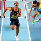 American Ashton Eaton, left, crosses the finish line while Ukraine's Oleksiy Kasyanov takes a tumble in the Men's 60-meter hurdle portion of the Heptathlon at the World Indoor Athletics Championships in Istanbul, Turkey.
