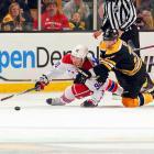 Capitals forward Marcus Johansson slides for a puck against the Boston Bruins.