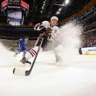 Chicago's Dylan Olsen sprays up some ice during a game at the St. Louis Blues.