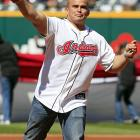 Marine Lance Cpl. Bryan Carpenter threw the ceremonial first pitch before the Cleveland Indians opening day game against the Toronto Blue Jays.