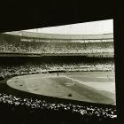 A view of a Giants game from underneath the Polo Grounds' right field overhang.