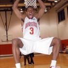 "Ohio State freshman forward Ivan Harris jokes around as he hangs from the rim during media day in October 2003. Harris was known as ""The Microwave"" for his ability to heat up immediately."