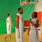 P. J. Hill interviews teammate Dallas Lauderdale in front of a green screen as teammates shoot around during media day in October 2009.