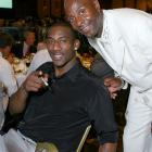 """STAT (""""Standing Tall and Talented,"""" his nickname) and former NFL great Jerry Rice buddy up at the Cedars-Sinai Sports Spectacular in June 2007."""