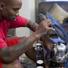 Marbury makes tea at home during a half-day holiday.