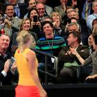 At one point, Wozniacki gestured for McIlroy to come onto the court.