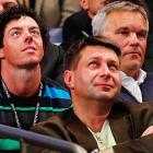 Rory McIlroy, Wozniacki's boyfriend, watched alongside Wozniacki's father, Piotr (right).