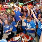 Kentucky fans celebrate after the final buzzer at Lynagh's Irish Pub & Grill at University Plaza on Woodland Avenue.