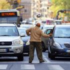 This fellow's parents obviously never warned him about playing in traffic. Here he is getting his jollies in Rome while trying to cadge some change from passing drivers.