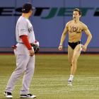 After the parking, ticket and concession prices at Toronto's Rogers Centre cost him his shirt and more, this poor fellow approached Red Sox infielder Nick Punto to beg for alms.