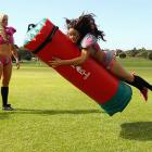 The Tampa Breeze linebacker, wearing what we understand is one of Nike's new NFL uniforms, showered some love on a tackle bag during the Australian 2012 Lingerine Football League All-Fantasy Game Tour. LFL All-Stars will be down under for two games in Brisbane and Sydney in June.