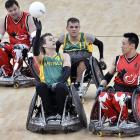 Australia's Chris Bond (second from left) passed the ball wheely well against Canada during their match in London on April 18.