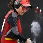 Turkish markswoman Cigdem Ozyaman limbers up her popgun at the Olympic shooting venue in London.