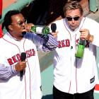 The former Red Sox stars reenacted one of the team's favorite locker room and dugout pastimes of last season while leading the crowd in a toast (or is it getting toasted?) during Fenway Park's 100th Anniversary Celebration on April 20.