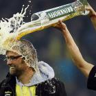 You've heard of beer goggles. Well, here's a beer hat, worn by Borussia Dortmund coach Juergen Klopp after his wild and wooly boys won the German Championship, 2-0, against Borussia Moenchengladbach in Dortmund on April 21.