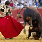 Tne French matador lives the old adage that sometimes one must take the bull by the tail and face the situation at the Maestranza bullring in Seville.