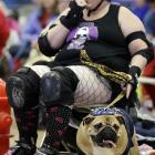 Leanne Sergio, of Ankeny, Iowa, sits with her dog Mya.