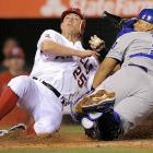 Royals catcher Bryan Pena makes a late tag on Los Angeles Angels' Peter Bourjos as he scores on a triple by Erick Aybar during the eighth inning of the Angels' 5-0 win.