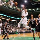 Celtics point guard Rajon Rondo (9) serves up a layup during Boston's 87-86 loss to the San Antonio Spurs.