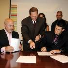 Harper signs his major league contract with his agent, Scott Boras, and National GM Mike Rizzo.