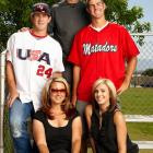 The Harper family (clockwise from left: Bryce, father Ron, brother Bryan, sister Brittany, mother Sheri) poses outside a Las Vegas field during a 2009 SI photo shoot.
