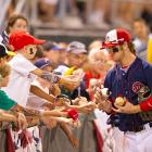 Harper, playing for the Hagerstown Suns, signs autographs before a game against the Lexington Legends