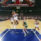 Charles Barkley drives past Larry Bird for the layup.  Barkley would finish his six-year tenure in Philadelphia fourth in team history in total points (14,184), third in scoring average (23.3 ppg), third in rebounds (7,079), eighth in assists (2,276) and second in field-goal percentage (.576) while earning six consecutive all-star appearances.