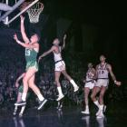 Wilt Chamberlain looks on as Don Nelson sinks a layup during a 1967 regular season game at the Boston Garden.  Nelson spent 11 seasons with the Celtics and won five championship titles between 1966 and 1976.