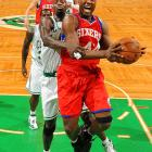 In Game One of the Eastern Conference Semifinals at TD Garden in Boston, Elton Brand 2 drives to the basket in front of Kevin Garnett.  Boston defeated Philadelphia 92-91.