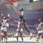 Bill Russell shoots a layup in front of Wilt Chamberlain during a 1968 NBA playoff game.  Russell would eventually lead the Celtics past the 76ers in six games and on to the Finals where the Celtics would capture their 10th title in franchise history by defeating the Lakers in six games.