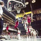 """Nate """"Tiny"""" Archibald tries to cut past Julius Erving on his way to the basket. Archibald was a six-time NBA All-Star and won his only career Championship with the Celtics in 1981."""