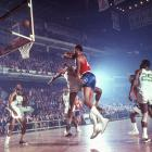 As Boston and Philadelphia renew their nearly 50-year old NBA rivalry, SI takes a look back at some classic photos of the Celtics vs. 76ers.   In this photo, Wilt Chamberlain throws an elbow at Bill Russell during a regular season game at the Boston Garden in Nov. 1965.  Chamberlain would average 28.7 points and 28.7 rebounds per game in 142 contests against his rival Russell, with a game high of 62 points on January 14th, 1962.
