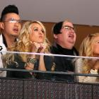 The sultry songbird (bottom left), shadowed by two shady characters (rear), was enthralled by Game 5 of the NHL Western Conference Semifinals between the Nashville Predators and the Phoenix Coyotes at Jobing.com Arena in Glendale, Arizona.