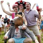 Having just cashed their tickets, celebrants surrounded I'll Have Another, the aptly-named winner of last weekend's Kentucky Derby, which appears to be a hat of some kind.