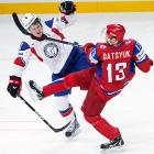 Tired of being mocked by hardcore hockey fans for its ban on fighting, the International Ice Hockey Fedeation has legalized decapitation. Here, Detroit Red Wings star Pavel Datsyuk attempts a head man (or is it a dead man?) pass the World Championships tournament.