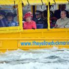 It's not quite a yellow submarine, but it's close enough for her majesty during her gala visit to Merseyside Maritime Museum in Liverpool.