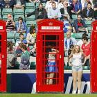 Change is required when using a phone booth, as these rugby cheerleaders demonstrated with their costumes during the Leinster vs. Ulster tilt at Twickenham Stadium in London on May 19.