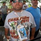 A race fan shows off his race ticket and t-shirt, both with the image of two-time Indy 500 winner Dan Wheldon.