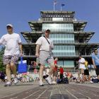 Race fans cross the yard of bricks in front of the Pagoda.