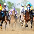 I'll Have Another (jockey wearing purple helmet) charged through the strongest field of horses in years to win the 138th Kentucky Derby.