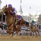 Jockey Mario Gutierrez rides I'll Have Another to victory in the 138th Kentucky Derby.