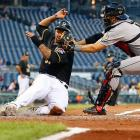 Pittsburgh's Jose Tabata receives what looks like an unpleasant tag by Houston's Jason Castro.