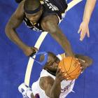 Memphis Grizzlies forward Zach Randolph pulls off the headband of Clippers forward Reggie Evans in Game 6 in their first-round playoff series.