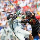 Loyola's Davis Butts and Maryland's Brian Cooper get tangled up as Butts loses his mouth guard during the lacrosse championships. Loyola came out on top, 9-3, winning its first-ever NCAA lacrosse title.