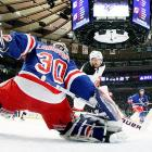 New Jersey Devils' Stephen Gionta scores a first-period goal against Henrik Lundqvist of the Rangers in Game 5 of the NHL Eastern Conference Finals.